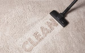 The Benefits Of Engaging A Professional Carpet Cleaner and 'Clean' being written on a carpet bycarpetcleaningwand