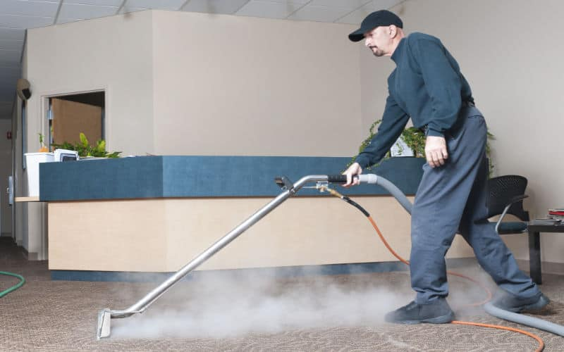 a business reception's carpet being steam cleaned