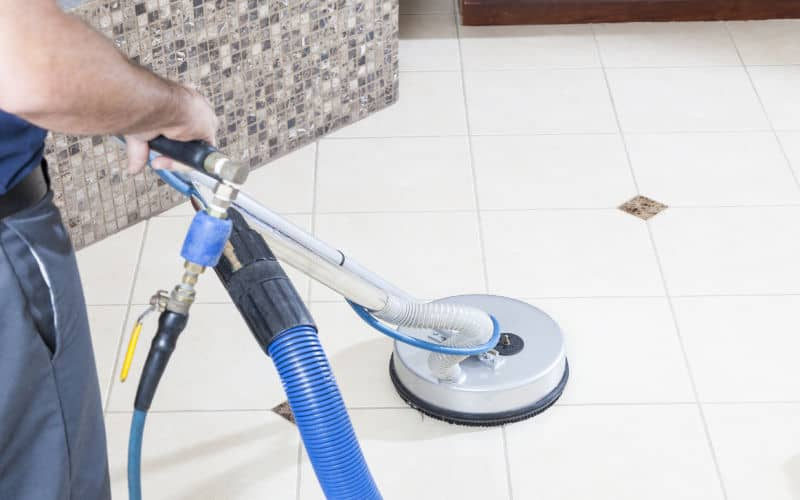 tiled floor cleaning by a rotary extraction machine