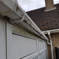 side view of a dirty conservatory gutter